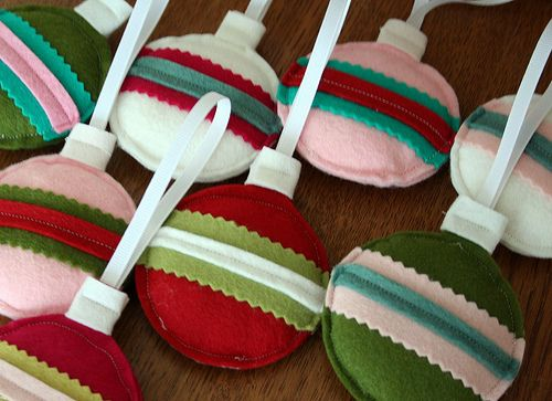 Felt ornaments. These look so fun & easy, but I got the feeling I'd spend tons of time fussing over details.