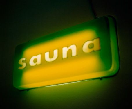 Close-up of a sauna sign