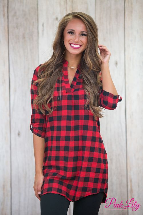There's no mystery about buying this new beauty! This classic red and black plaid tunic dress features a v-neckline and adorable collar!