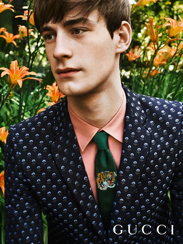 A silk tie in the Gucci Garden features a woven tiger motif, Gucci Gift, worn with Gucci Tailoring.
