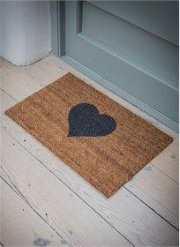 A fun doormat with a grey heart decoration