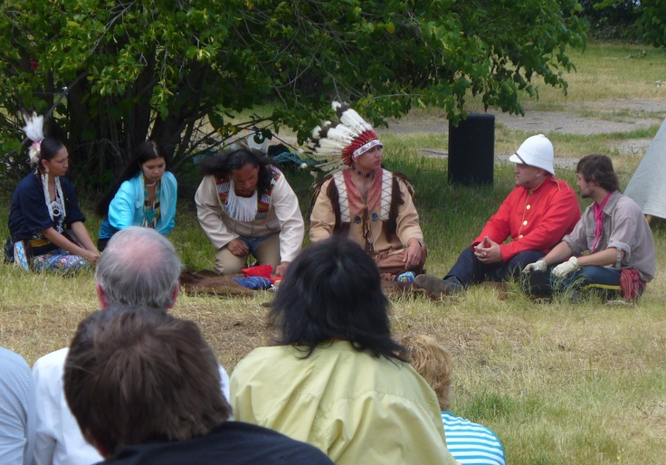 Reenactors portray a Metis interpreter, Major Walsh, Sitting Bull and his people as they sit down to smoke the Peace Pipe at the 2012 production of The Medicine Line.  http://www.inkwellinspirations.com/2012/08/the-medicine-line-outdoor-show.html