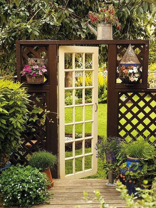 door as gate..love this entry to the back yard