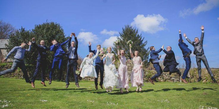 Bride & Groom, Bridesmaids & Groomsmen jumping for joy @ Trevenna Wedding Venue Cornwall