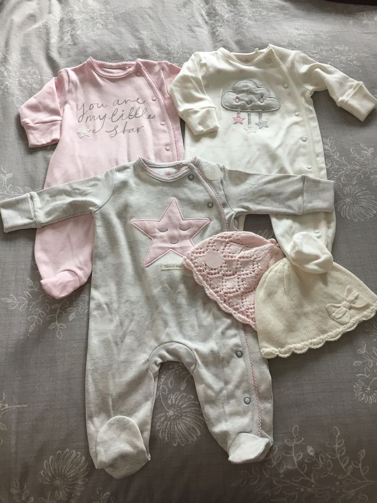 Love these newborn baby grows and hats we got as a present. Think she'll be coming home in one of these. All from Next.