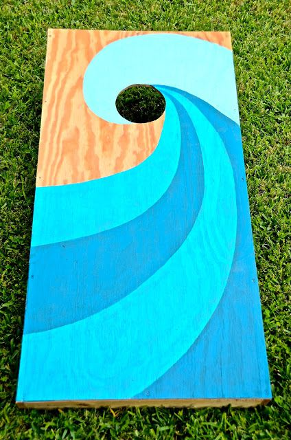 Love this wave painted Cornhole board. | Girl With A Surfboard | LFF Designs | www.facebook.com/LFFdesigns