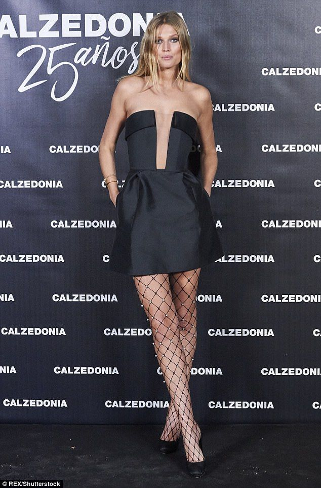 Fishnet fashion: Toni Garrn looked incredible in a thigh-skimming black sleeveless dress and pearl detailed fishnet tights at Calzedonia's 25th anniversary in Madrid on Thursday night.
