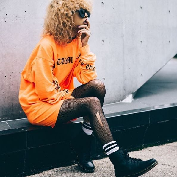@thelmaaoyama styles our #DMsLite Newton with bright orange and athleisure details. Shop here.