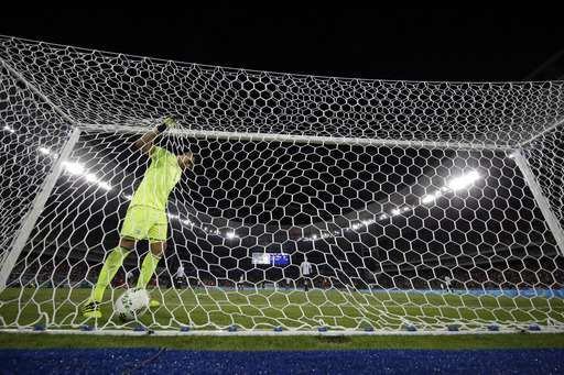 Argentina goalkeeper Geronimo Rulli goes back for the ball after Portugal's Pite scored during a group D match of the men's Olympic football tournament at the Rio Olympic Stadium in Rio De Janeiro, Brazil, Thursday, Aug. 4, 2016. Portugal won 2-0. (AP Photo/Leo Correa)