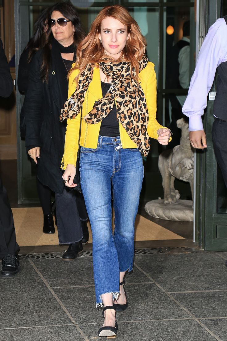 Emma Roberts brightens things up by adding a vibrant yellow leather jacket with her cut off jeans and black tee