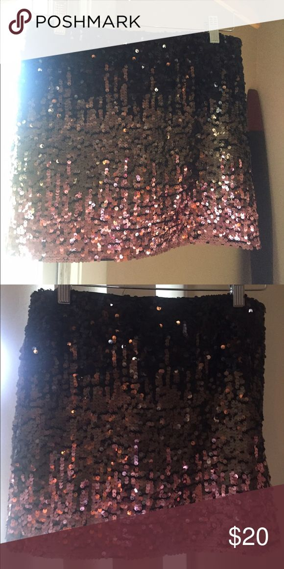 Gorgeous sexy little sequin mini skirt. Brand new! Hi!  This is a great little mini skirt that is brand new and never worn (no tags tho!)   It is 3 shades - pink, gold, black and a size Medium. It was from a little boutique shop so no particular brand.  Great for a girls night out!!!  Skirts Mini