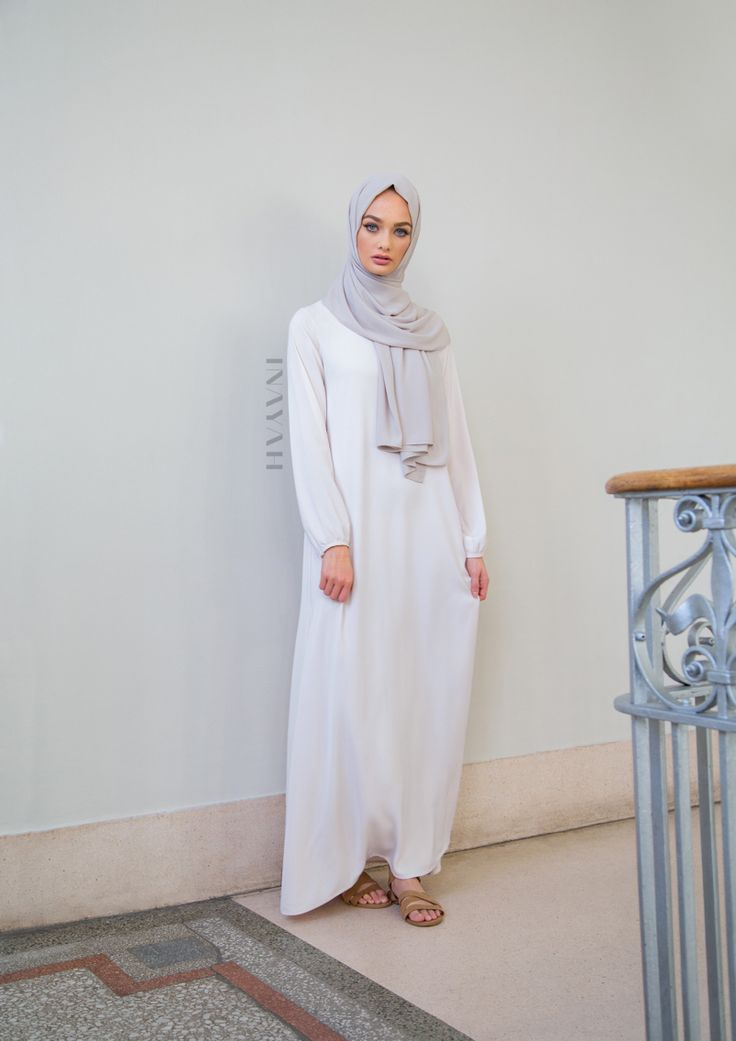 Understated timeless designs and elegant, modest coverage. Style with our without belt. Available instore and online: Nude Classic #Maxi with Belt + Feather Grey Rayon #Hijab - www.inayah.co