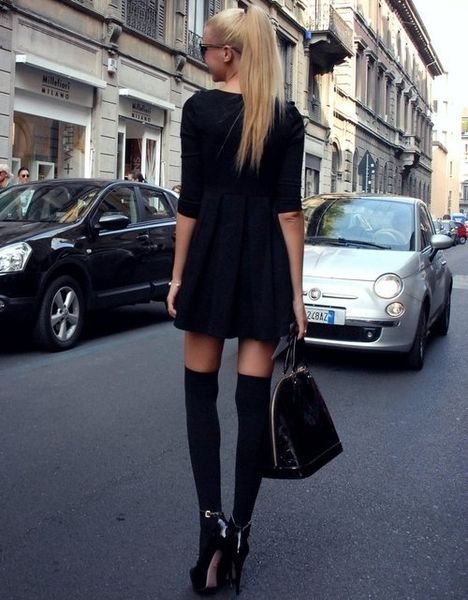 Black Chic - look carefully, she's not wearing boots, but pumps with knee-high stockings.....nice