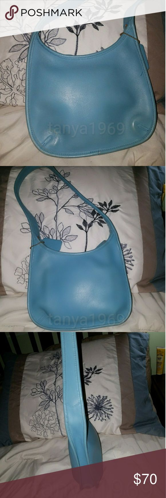 Vintage Robin egg blue Coach Ergo hobo 9020 Authentic Vintage Coach Ergo hobo in rare robin egg blue. Matching hang tag is attached . 1 interior slip pocket Serial number j7D-9020. Made in USA. Light patina, appears a number was stamped in the bottom interior, see pics. Coach Bags Hobos