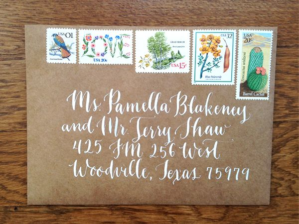 Kraft Envelope With White Calligraphy And Vintage Stamps
