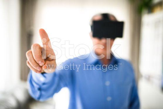 mature man entartains his self with virtual reality device simulator royalty-free stock photo