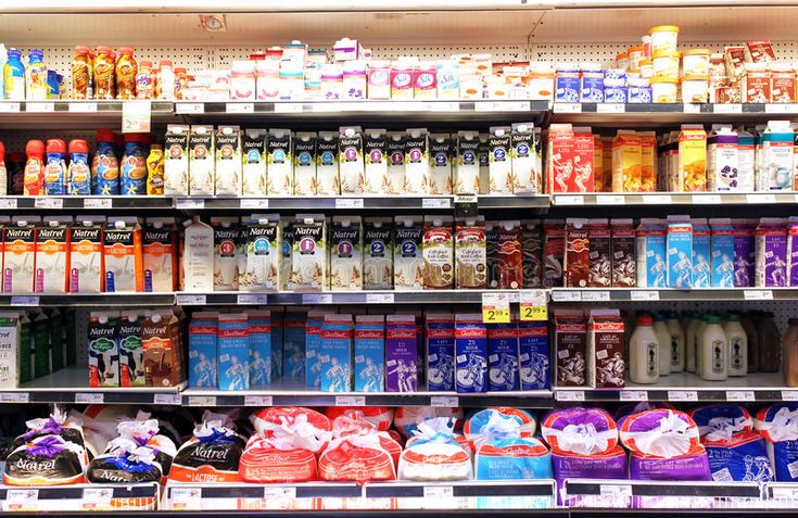 Milk and dairy products. On shelves in a supermarket , Ad