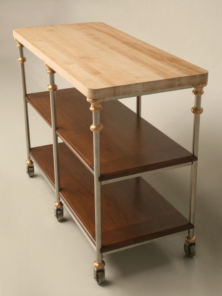 shallow stainless steel kitchen island with oak shelves