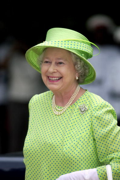 Queen Elizabeth, 2002. Love this dots on the Queen Mother dress and love her style.