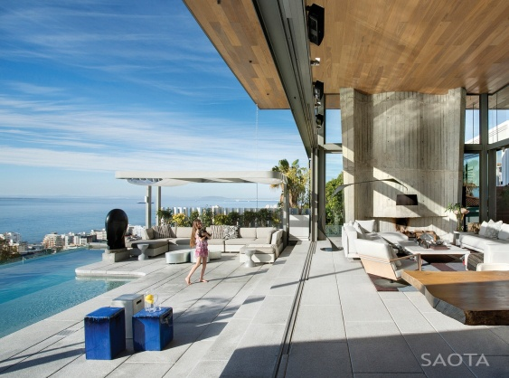 """Residential Architecture: De Wet 34 House by SAOTA – Stefan Antoni Olmesdahl Truen Architects: """"..The site is positioned in the heart of Bantry Bay in Cape Town, South Africa, on the slopes of Lion's Head overlooking the bay. The brief was to create a home with all the spectacle of an Atlantic Seaboard showpiece but also to respond to the practical needs of family life and to create a feeling of sanctuary..Built over four floors, the living areas are open-plan yet have distinct identities. A…"""