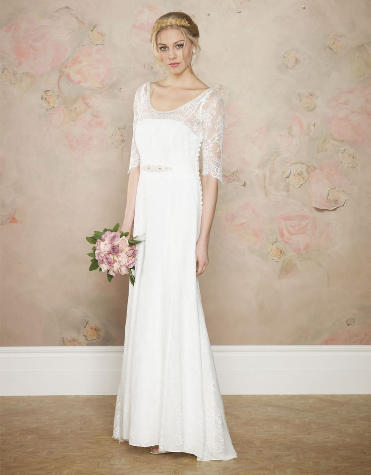 Carlotta Bridal Dress | White | Monsoon 3531574610 $525   Walk down the aisle head to toe in our most luxurious lace, w/ intricate scallop detail to the ¾ length sleeves & hemline. ...features a flattering Sheathe Skirt w/a slight Trumpet, set off w/a hand-embellished waistband of diamante, bugle & pearl. Additionally, the scooped back & neckline are highlighted w/a trimming of pearls & silver beading.