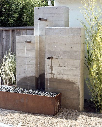 Use of cinder blocks and mortar with pvc pipe extending out. Three pumps were possibly used with water return and pump(s) located in large basin, making this an easy clean. Will update design further as building. --mary sherwood [Concrete + Corten Fountains]
