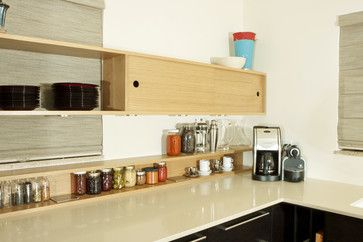 Some spice storage ideas. I like the idea of spice shelves running the full length of walls with cupboards.