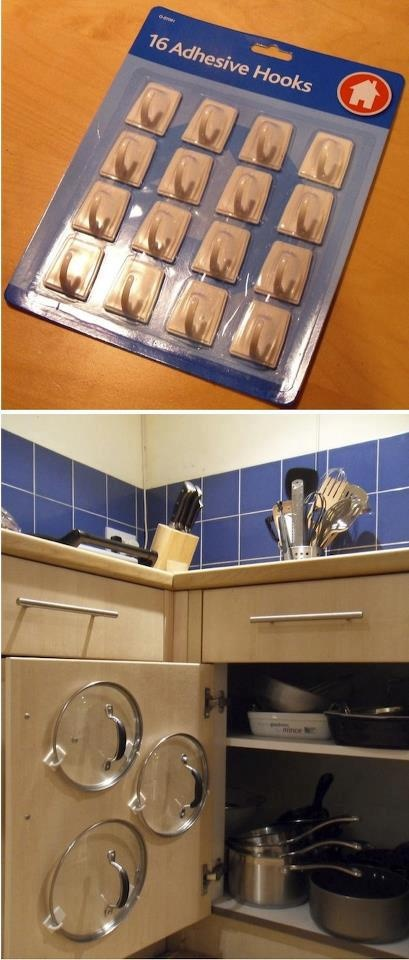Adhesive hooks inside cabinet door for lid storage.