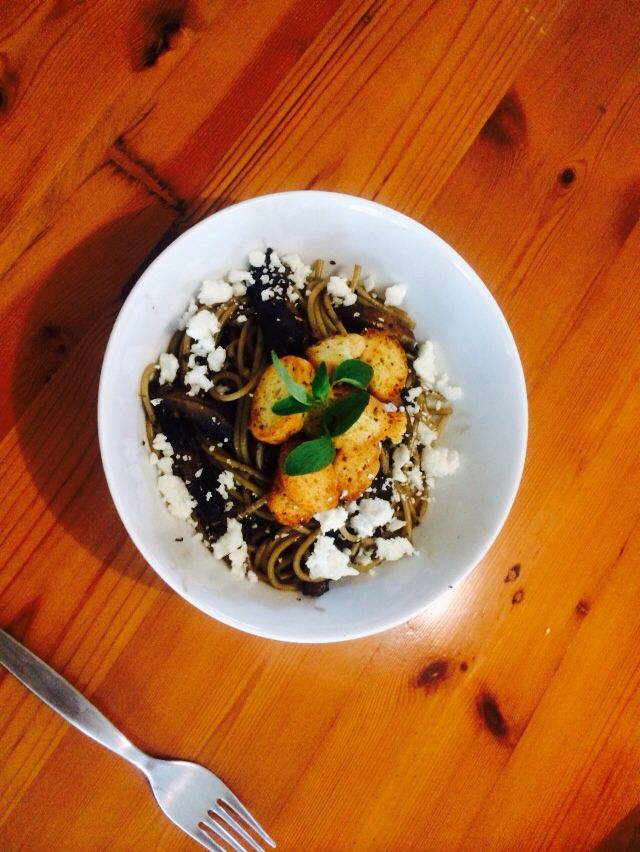 Black garlic spaghetti with herb croutons and goats milk feta.