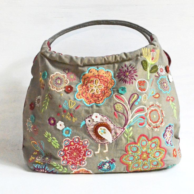 Through a fair trade company, this irresistibly colorful canvas bag is handmade in Northern India. It features gorgeous embroidery and appliqué, a roomy interior, small zippered pocket, and a magnetic
