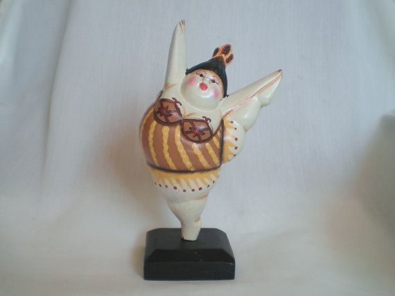 www.etsy.com/shop/ExtravaganzaBali  Wood carved dancer painted with acrylic colors. High 20 cm. High 7,87 inches.   $12.90 USD