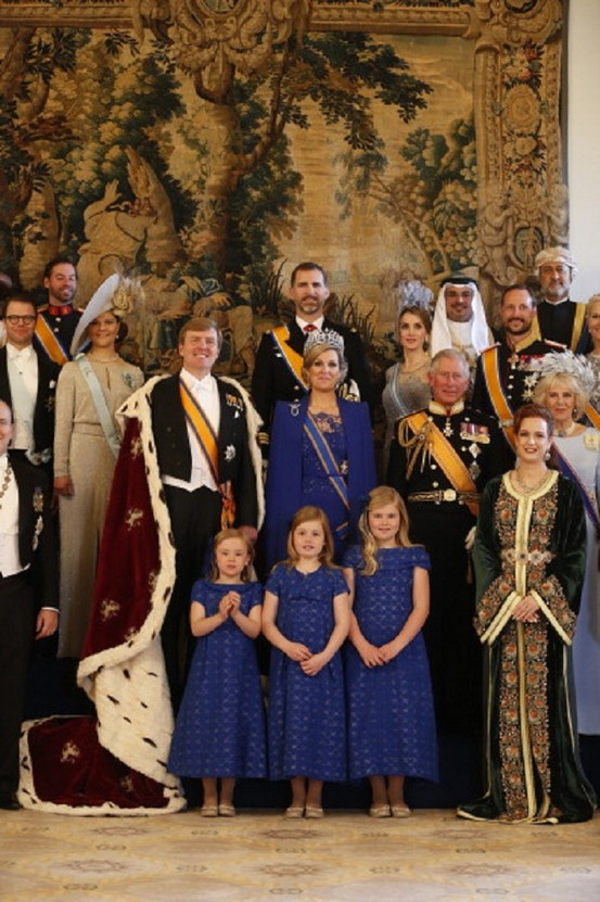 King Willem-Alexander of the Netherlands (C, L) and his wife Queen Maxima (C, R) pose for a photo with their childre, members of the royal household, heads of state and government and special guests at the Royal Palace in Amsterdam