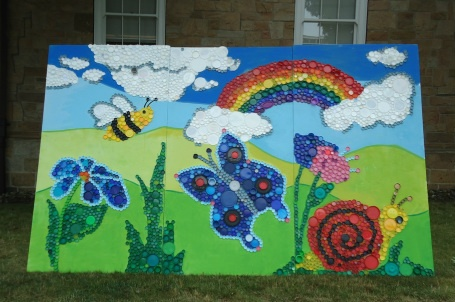 Large rainbow and butterfly bottle cap mural