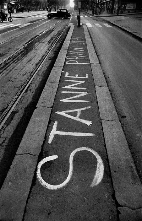 Josef Koudelka. Prague, Aug 1968 Warsaw Pact troops invade Prague. A streetcar stop with the announcement of the 9 pm to 5 am. curfew ordered under the state of siege