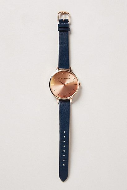 rose gold head and navy watch