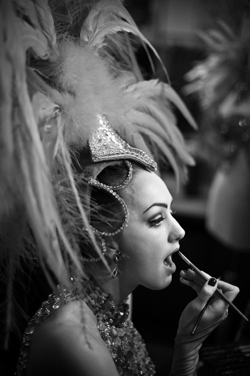 Moulin Rouge.Vintage showgirl. Note the eye makeup and the classic pattern of pale lid and dark socket line.