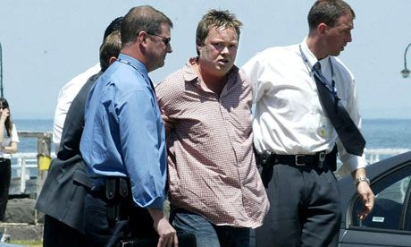 Carl Williams in the custody of Taskforce Purana officers, following his arrest in 2004 for his role in the Melbourne Gangland war. Photograph: Angela Wylie AJW/Danny John