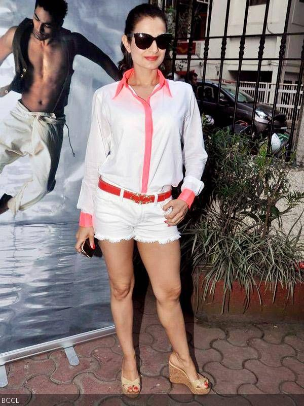 Ameesha Patel raises temperature in denim shorts and white shirt at designer Shahid Amir's collection launch, held in Mumbai, on October 29, 2013.