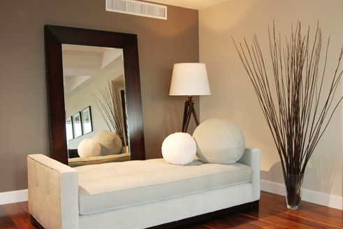 Over sized wide frame mirror tilted against the wall gives depth and character to a small space: Entryway/ Foyer or any small room.