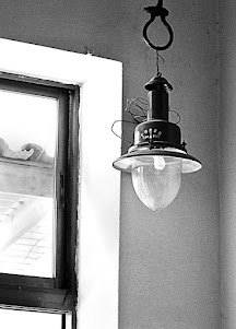 An industrial style lamp hanging in a taverna i Marathokampos; Samos, Greece. Colours killed this photo, so I made a black and white conversion.