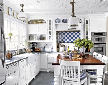 I love a white kitchen.  Don't know how I'd keep this clean, but I love the plate rack, farmhouse sink, and blue and white plates.  I'd replace the eat in kitchen table with an island of some sort, but the overall sceme here is my style.