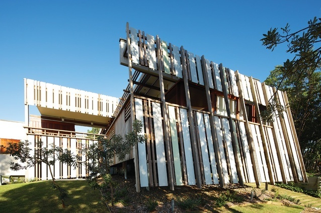 A pattern of cement sheets and timber screen the afternoon sun. north stradbroke is.