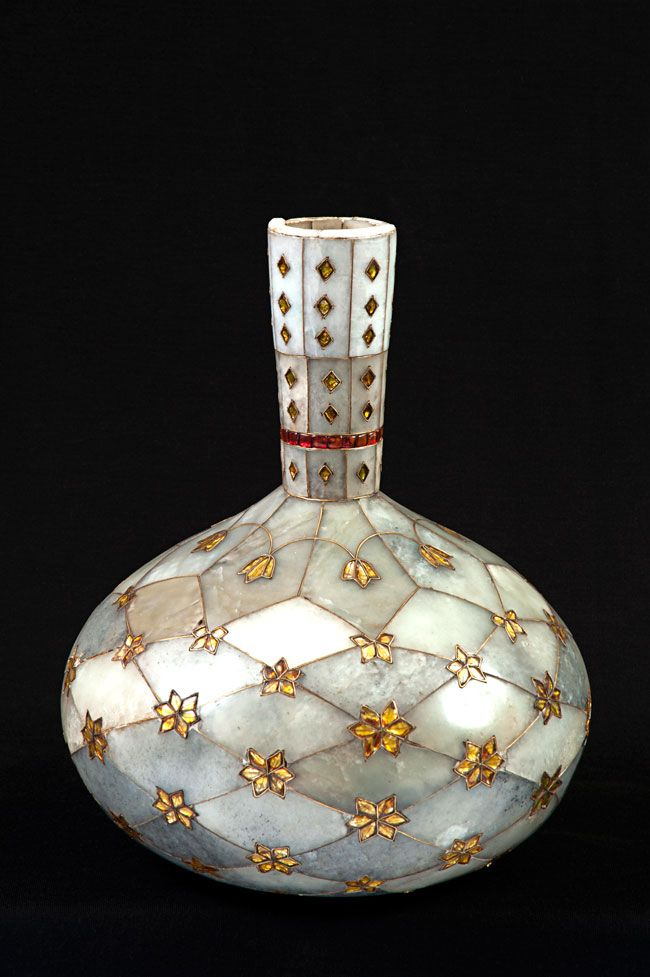 Surahi, the vessel with high neck 18th century Place of Origin: Mughal Materials: Jade, gold wire and leaf, glass and ruby |