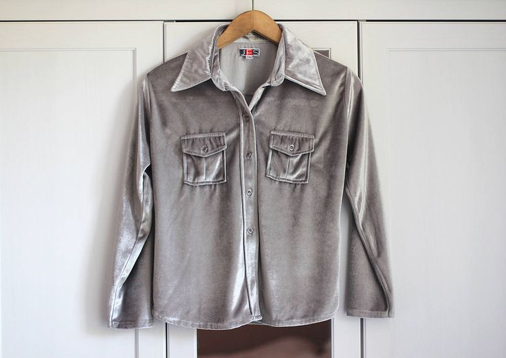 Vintage blouse  *Classic shirt fit *Silver/shiny gray colour *Soft and comfy *Retro style *Velvet/satin look    Size: Medium  Bust: 38 1/4 inch / 97 cm Length: 22 inch / 56 cm Outer Sleeve: 20 1/2 inch / 52 cm Inner Sleeve: 15 1/2 inch / 40 cm      You can also check other tops from my shop: https://www.etsy.com/shop/sisuvintagestore?section_id=21302542     --- SHIPPING ---  Every parcel is shipped as registered priority. S...
