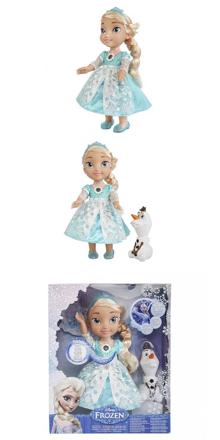 """Disney Frozen - Muñeca Elsa brillo de nieve [canta en inglés]. Figura de alta calidad y diseñada con todo detalle. Si presionas la cadena mágica suena la canción """"Let it go"""". Lleva a su amigo Olaf"""