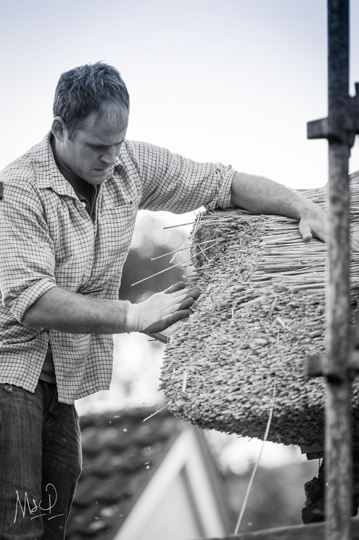 A Thatcher craftsman, hand finishing touches, attention to detail.  For more from Exmoor by Mark www.exmoor.photography