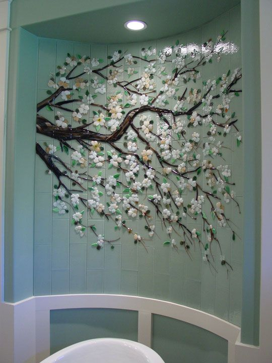 Bathroom tile installation by Designer Glass Mosaics. If you love this look.. You could easily do this in a bedroom by painting a branch and gluing on flowers.
