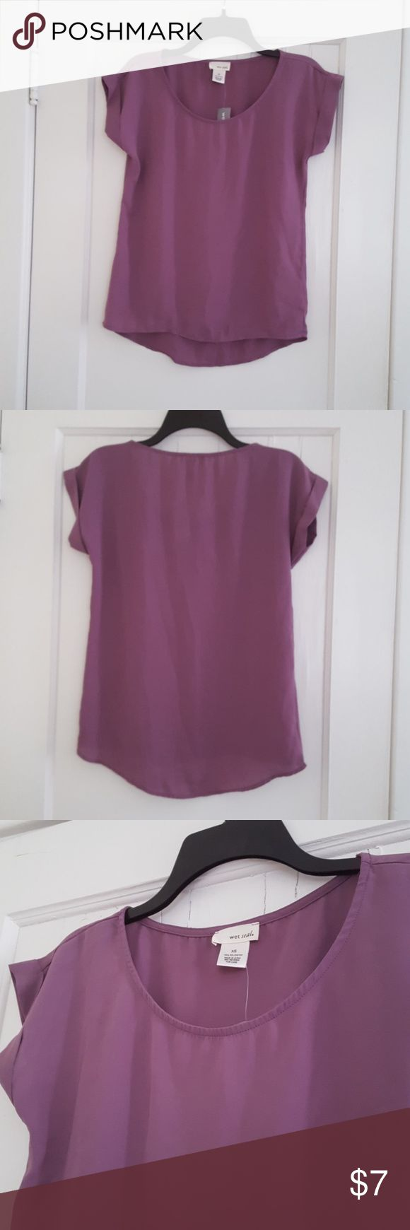 NWT Short sleeve semi-sheer top Purple short sleeve top is 100% polyester and has a loose flowy fit. Never worn and purchased right before Wet Seal discontinued, and has the original tags on it. Semi-sheer. Wet Seal Tops
