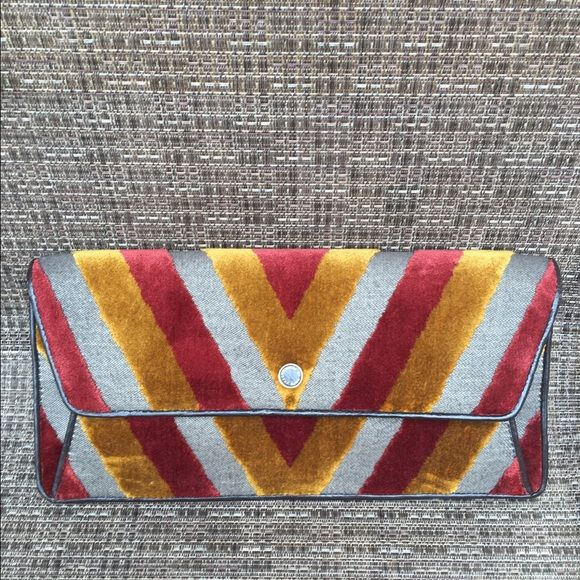 🎉SALE🎉Marc Jacobs clutch.  NWOT Marc Jacobs multicolor clutch.  New without tags.  Never worn.  Great colors and piece to wear for the Fall and winter season! Marc by Marc Jacobs Bags Clutches & Wristlets
