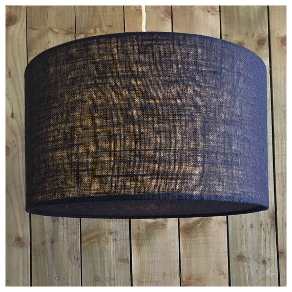 This stylish hessian lightshade & coordinating diffuser is handmade in our Bristol workshop from hessian fabric in black ▪️Fabric - black Hessian ▪️Made to order within 5 working days ▪️ Measures - Various Sizes ▪️Diffuser included. Diffusers are perfect for when shades are hung from high ceilings, they draw the eye to the shade design rather than the frame & bulbs ▪️European fitting (40mm) with a British adaptor (28mm) will fit all types of lampholder ▪️ Energy saving bulb recomm...